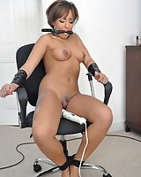Slut taped to a chair and forced to cum