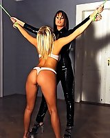 Kinky lesbians in bound spanking set in latex
