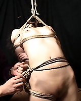 Slave and Master achieve a very artisitc rendering of Shibari bondage technique